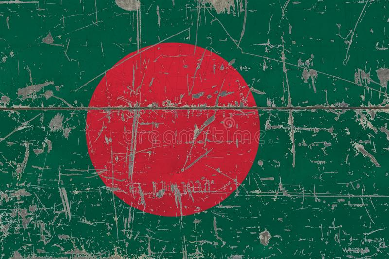Grunge Bangladesh flag on old scratched wooden surface. National vintage background royalty free stock photography