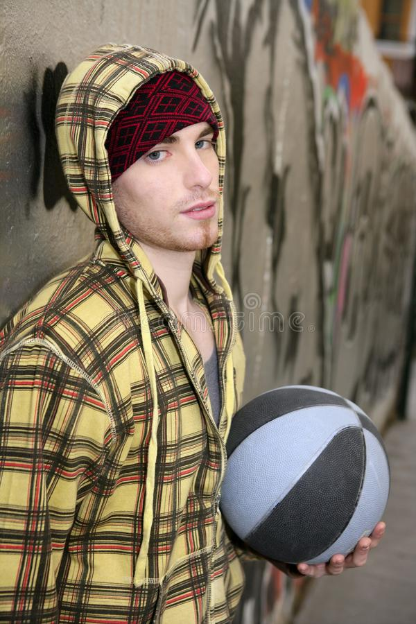 Grunge basket ball street player on brickwall. With cup stock photography