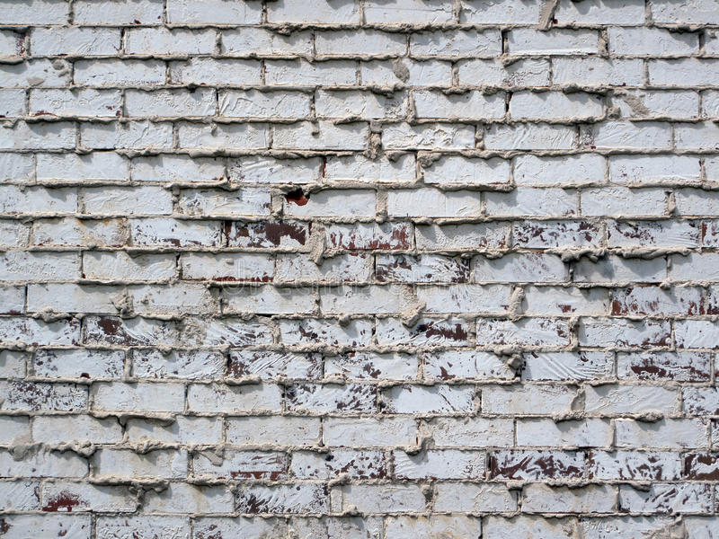 Grunge Brick Wall. A rugged unfinished looking grunge textured brick wall stock photo