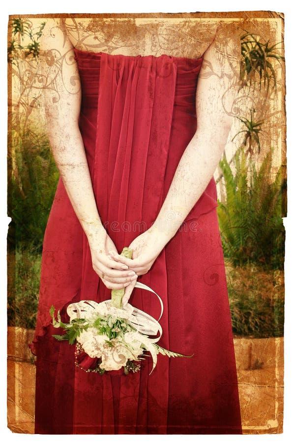 Grunge bride in red silk dress stock photos