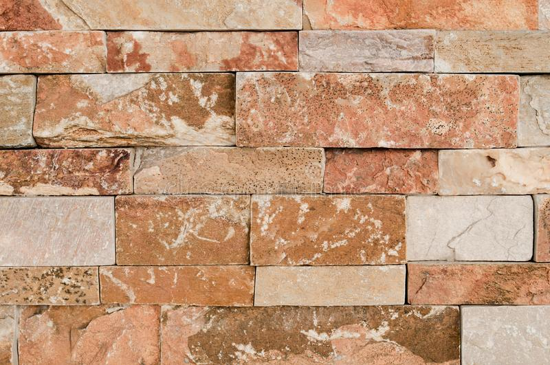 Grunge brown ,beige,orange,grey stone wall tiles texture backdrop.Wall natural brown stone dirty,dust.Wall and panel marble natura royalty free stock photography