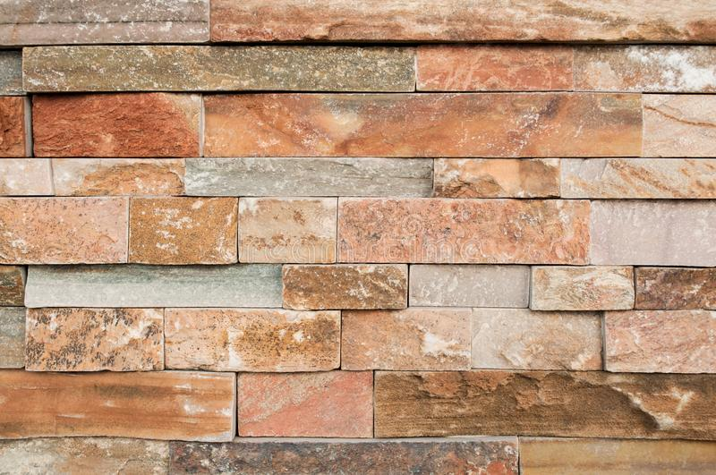Grunge brown ,beige,orange,grey stone wall tiles texture backdrop.Wall natural brown stone dirty,dust.Wall and panel marble natura stock photography
