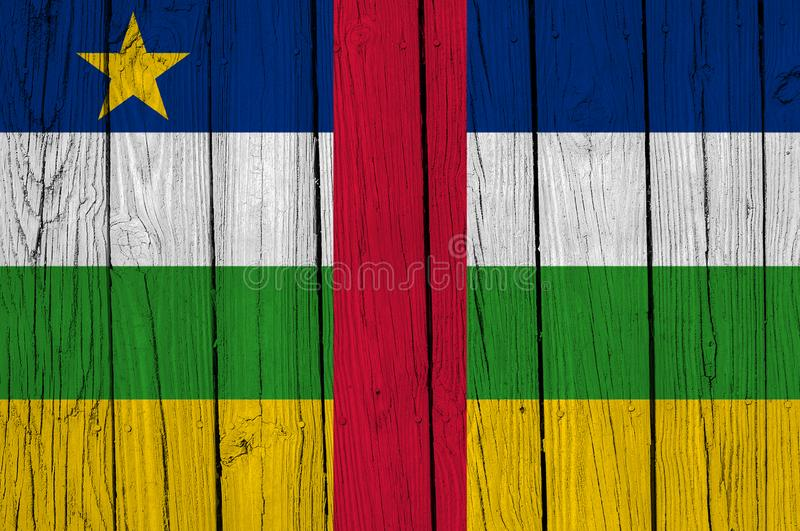 Central African Republic Flag Over Wood Planks. A grunge Central African Republic flag over wood planks stock image