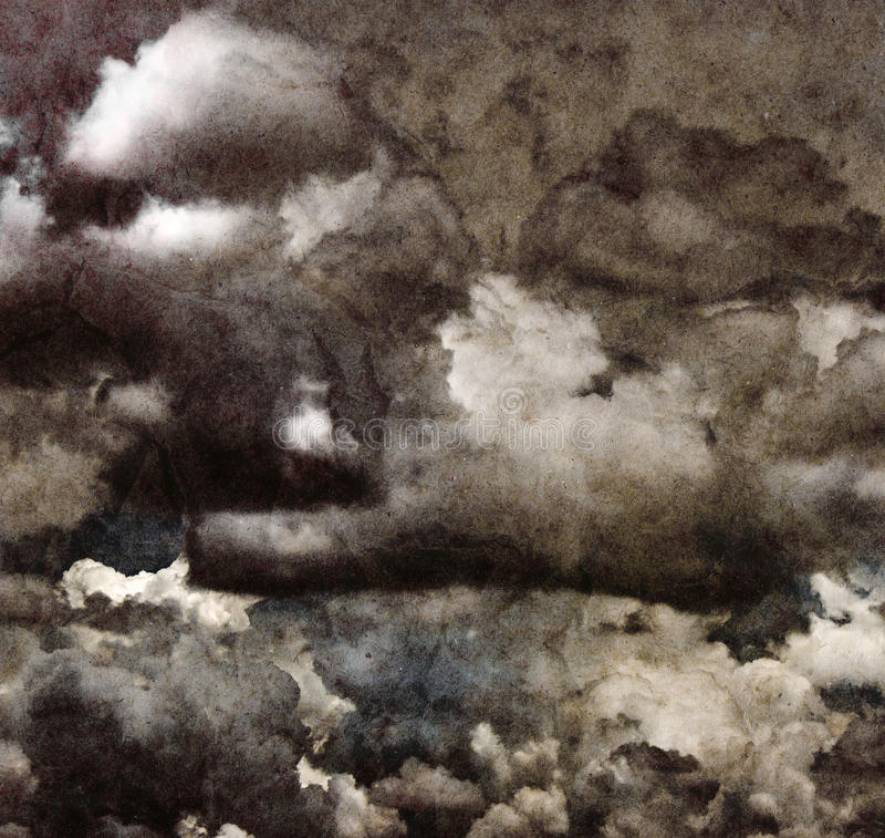 Grunge clouds on recycle paper.