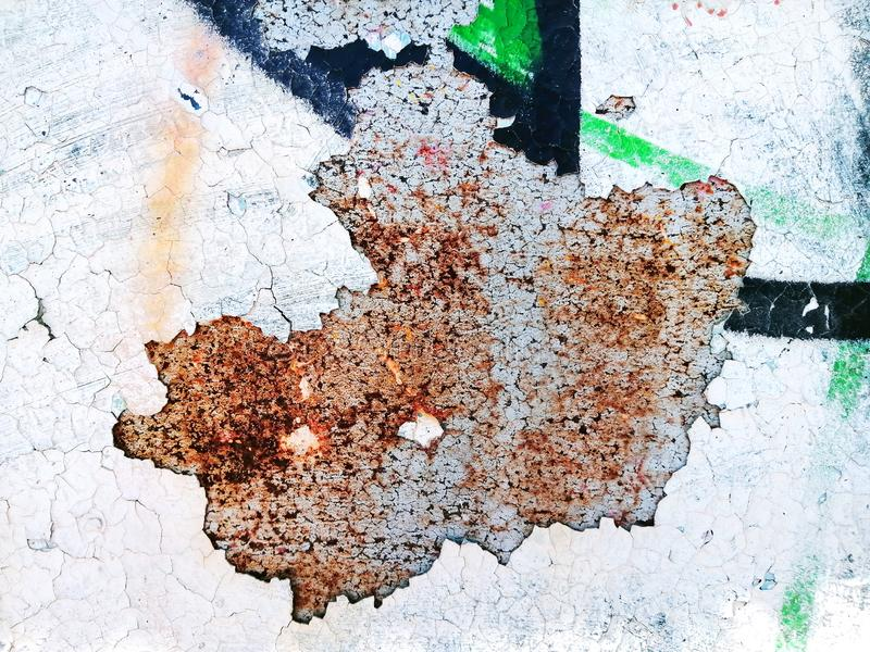 Grunge colorful background, peeling paint texture, cracks on concrete, rust on metal, aged grafitti royalty free stock photography