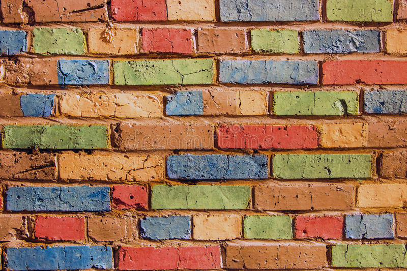 multi-colored children's brick wall background stock images