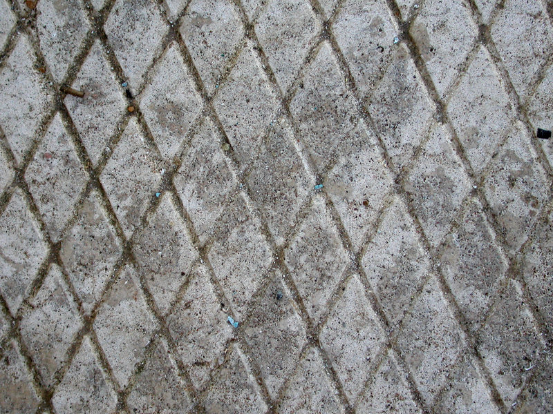 Grunge Concrete Stone Textures. A patio brick texture, worn, faded and well-used. Useful as a background, layer or texture royalty free stock photo