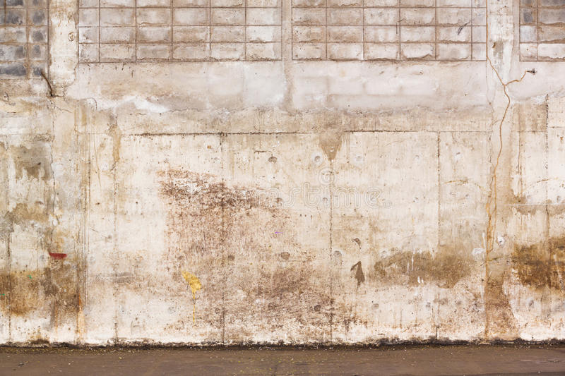 Grunge concrete wall. Weathered and grunge concrete wall inside old warehouse building stock images