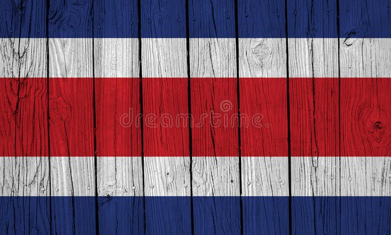 Grunge Costa Rica Flag Over Wood Planks. A grunge Costa Rica flag over wood planks royalty free stock photography