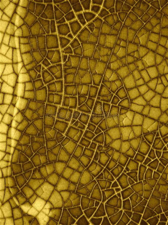 Grunge Cracked Glass Texture. An abstract texture pattern of a cracked surface in gold and brown colors on an aged, faded and worn background royalty free stock image