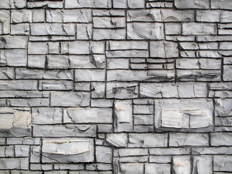 Grunge Crafted Old Rock Wall. A grunge crafted simulated textured cement styled old stone wall stock images