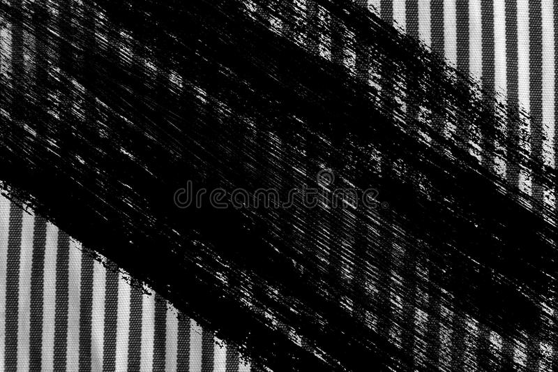 Grunge dirty Black and white closeup of stripped fabric texture royalty free stock image