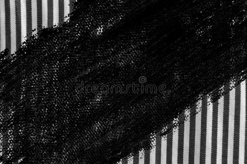 Grunge dirty Black and white closeup of stripped fabric texture royalty free stock images