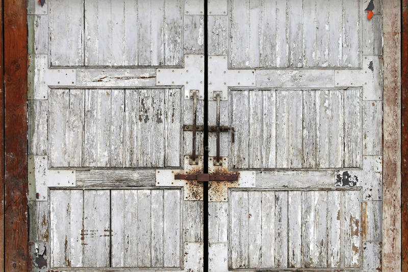 Grunge doors. Old grunge timber door at abandon warehouse royalty free stock images