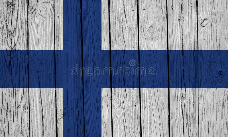 Finland Flag Over Wood Planks. A grunge Finland flag over wood planks stock images