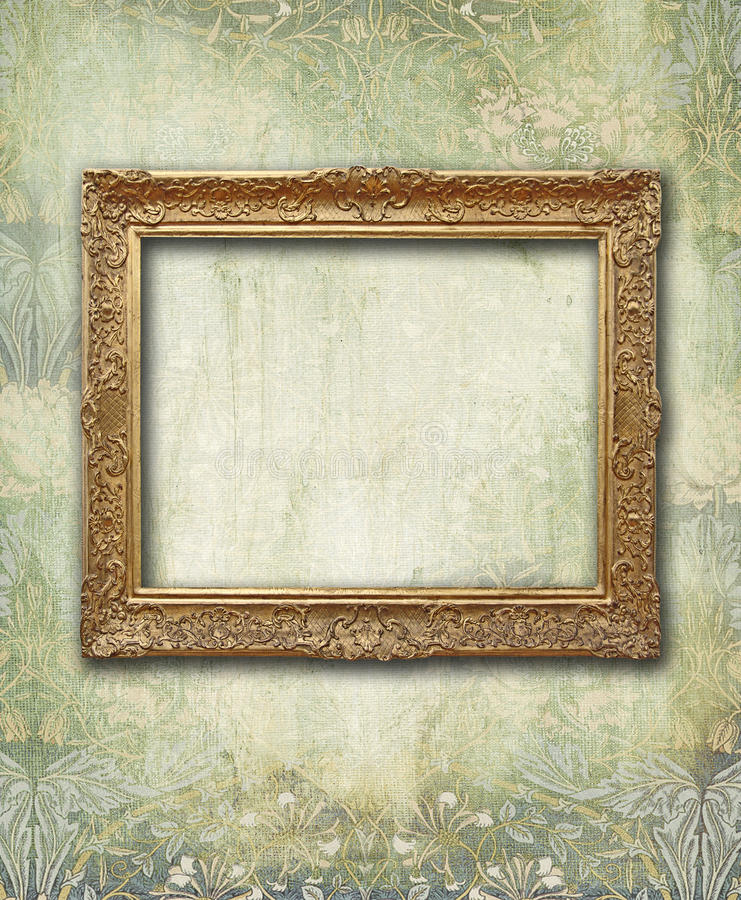 Grunge floral faded wallpaper with golden antique empty frame stock image