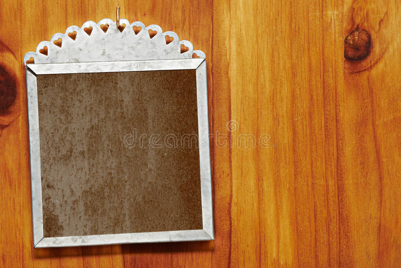 Grunge frame on wood. royalty free stock image