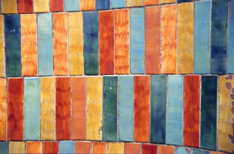 Grunge gekleurde tegelachtergrond royalty-vrije stock afbeeldingen