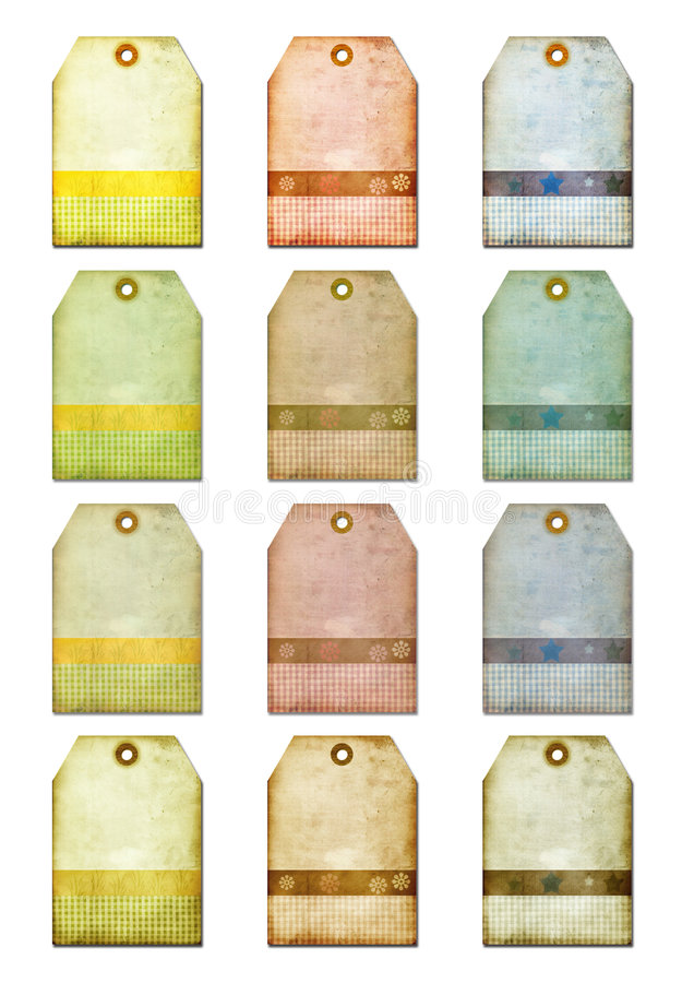 Grunge gift tags-labels for scrap-booking. Tags in neutral, pastel colours with antique finish and detail, as well as torn and damaged surface stock photography