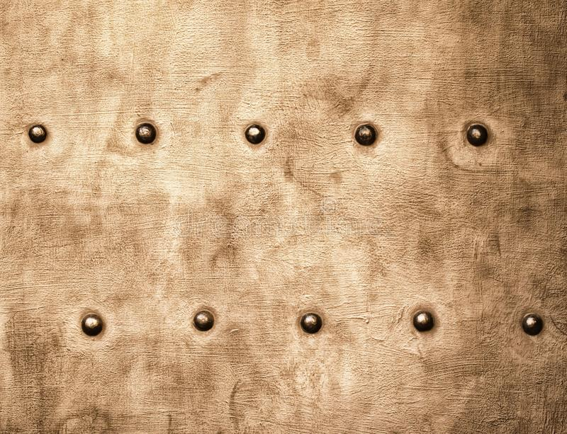 Grunge gold brown metal plate rivets screws background texture royalty free stock photography