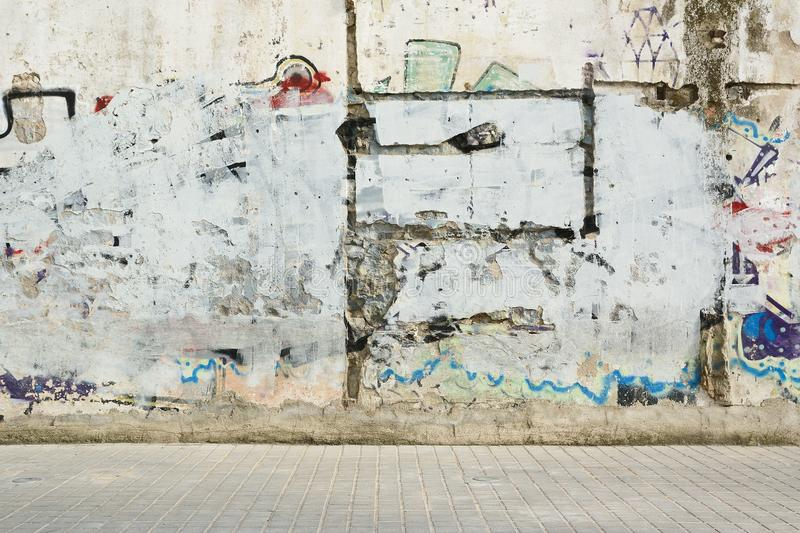 Grunge graffiti painted wall and sidewalk. Street style background and empty copy space. royalty free stock images