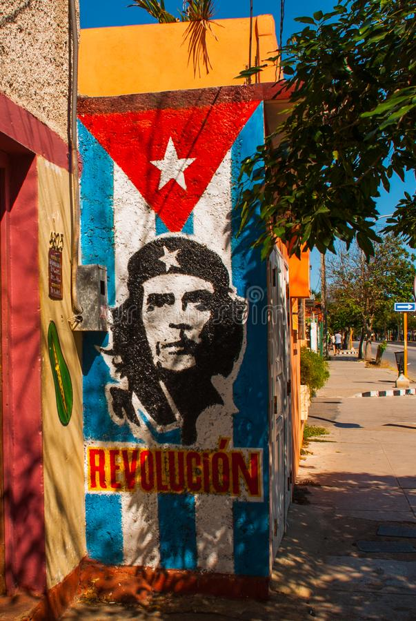 Grunge graffiti portrait of Che Guevara and Cuba flag on the wall. Varadero. Cuba. Grunge graffiti portrait of Che Guevara and Cuba flag on the wall. After his royalty free stock images