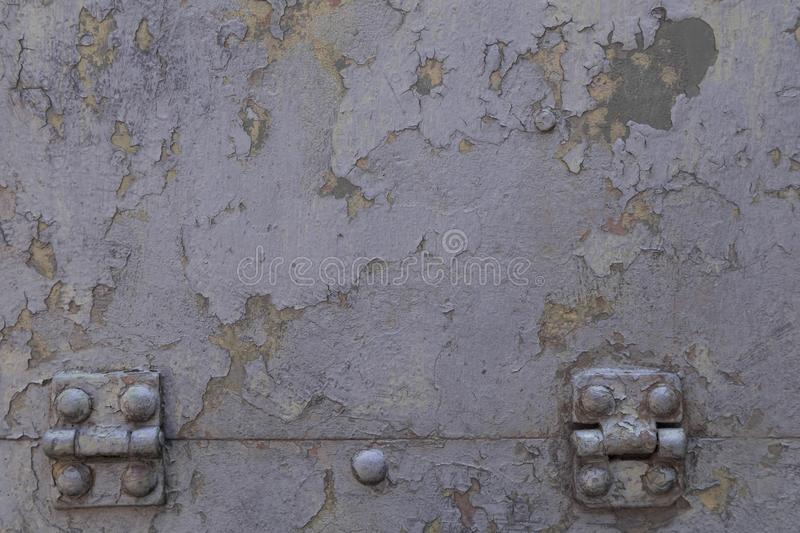 Grunge gray metal iron texture background with loops and bolts. Space for text or image royalty free stock image