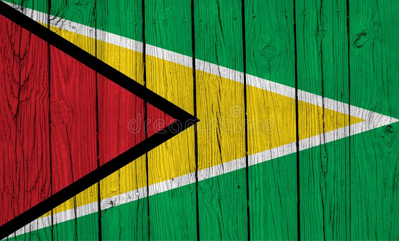 Grunge Guyana Flag Over Wood Planks. A grunge Guyana flag over wood planks royalty free stock photography