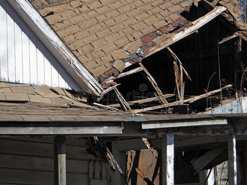 Grunge House with a Collapsed Roof. stock photos