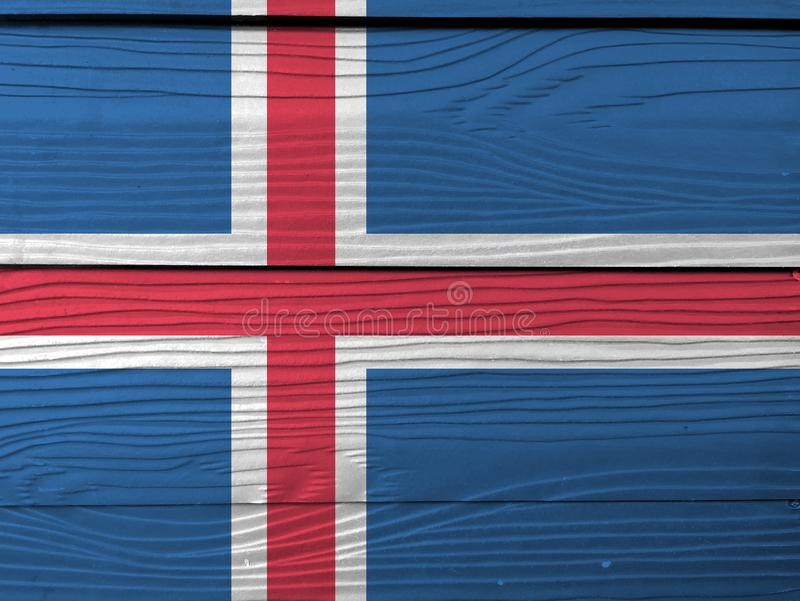 Grunge Iceland flag texture, blue sky with a snow-white cross, and a fiery-red cross inside the white. stock image
