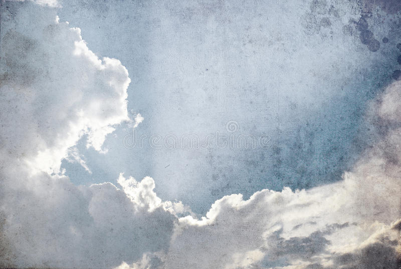 Grunge image of cloud in the sky. Grunge image of sun and cloud in the sky royalty free stock image