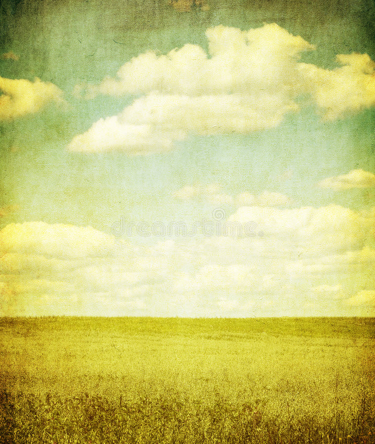 Grunge image of green field and blue sky royalty free illustration