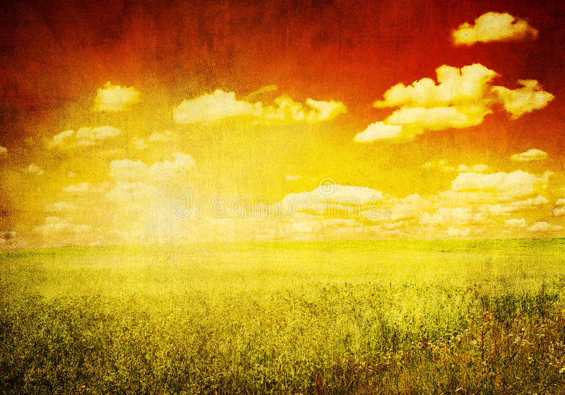 Grunge image of green field and blue sky royalty free stock image