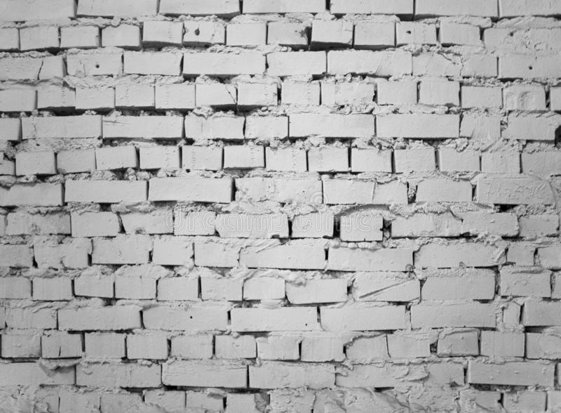 Grunge industrial white brick wall background in Kyiv, Ukraine. royalty free stock photography
