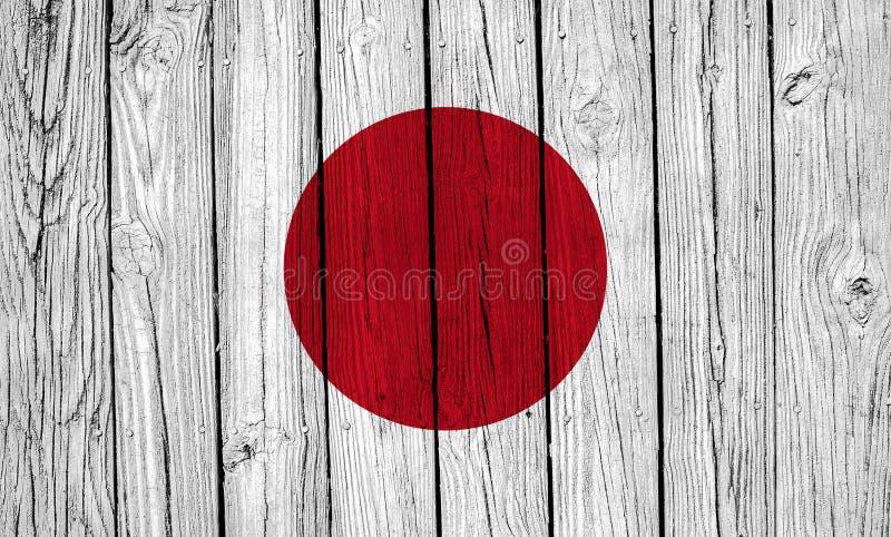 Grunge Japan Flag Over Wood Planks. A grunge Japan flag over wood planks royalty free stock photography