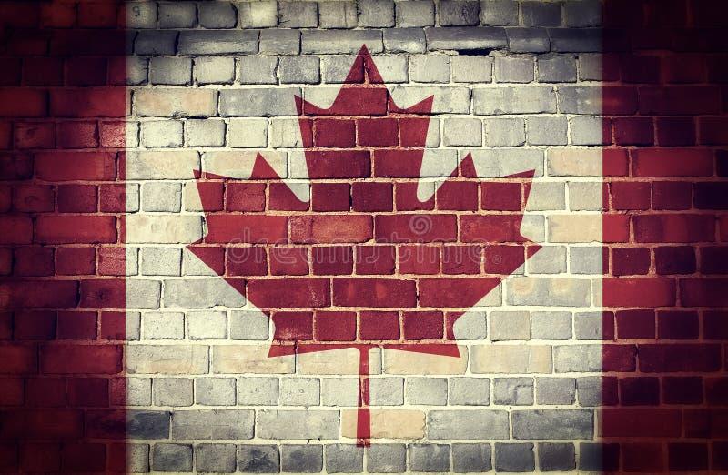 Grunge Kanada flaga na ściana z cegieł obraz stock