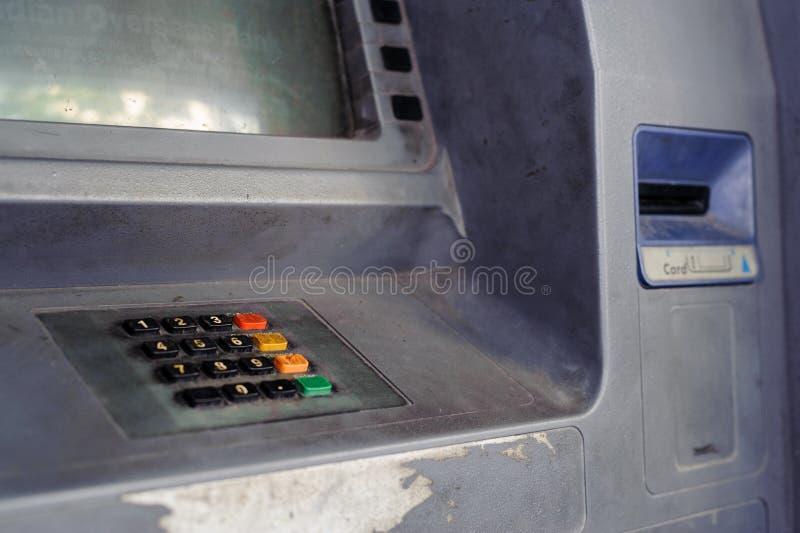 Grunge keypad and card insert slot of abandoned ATM stock images