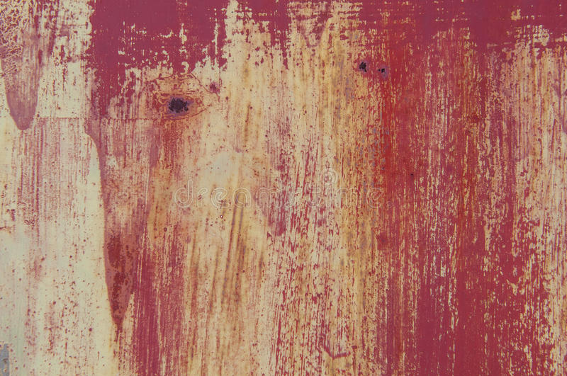 Grunge metal. Background. Abstract texture on an old red metal door stock photos