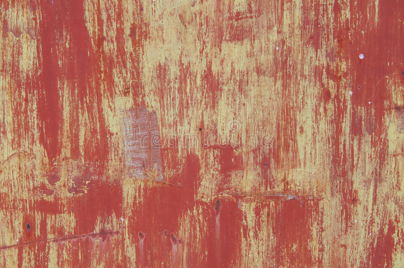 Grunge metal. Background. Abstract texture on an old red metal door stock photography
