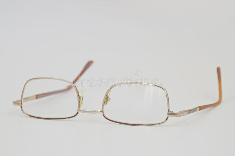 Grunge metal glasses on light grey background inverted stock photography