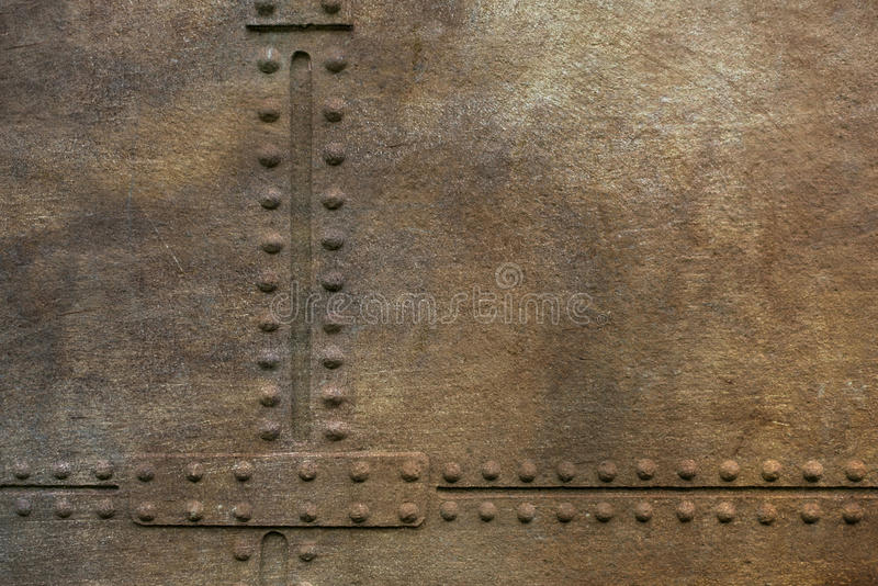 Grunge metal plate with rivets. As background stock image
