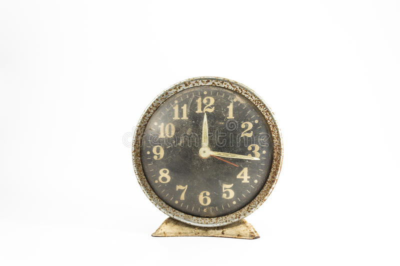 Grunge old alarm clock in isolate background decoration. Grunge retro alarm or old clock on isolated white background decoration design royalty free stock photography