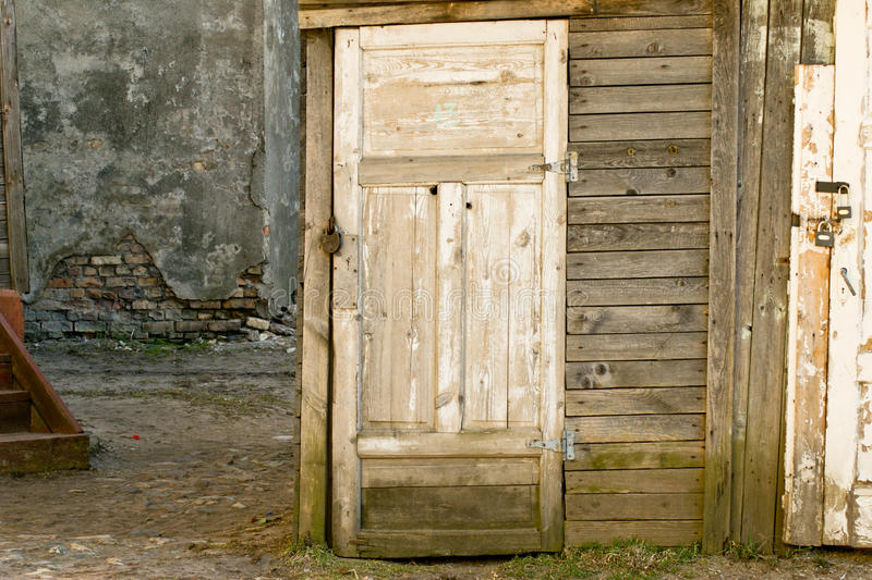 Grunge old door with number 13 stock photo