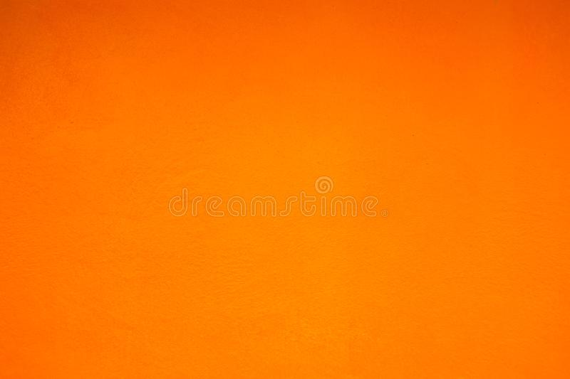 Grunge orange plaster wall with smears stock image