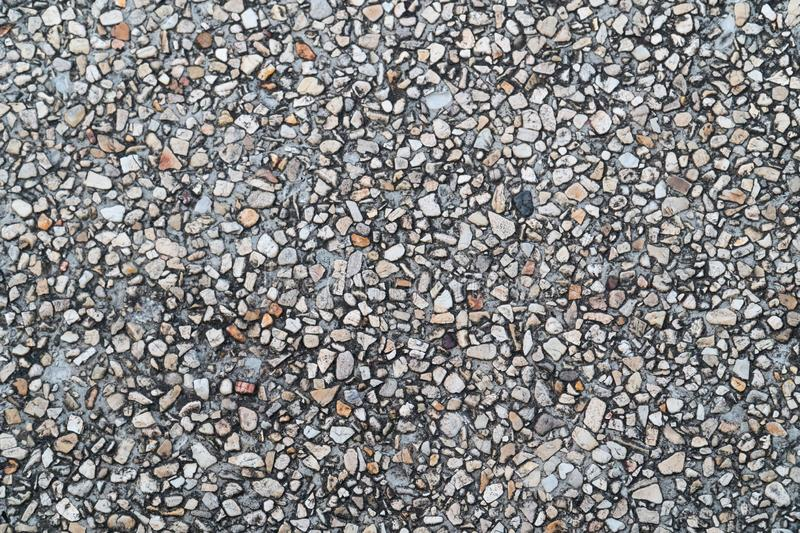 Grunge pebble floor as seamless textured background.Small pebbles mixed with sand texted background royalty free stock photography