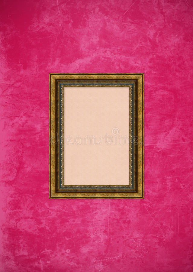 Grunge pink stucco wall with empty picture frame royalty free stock photography