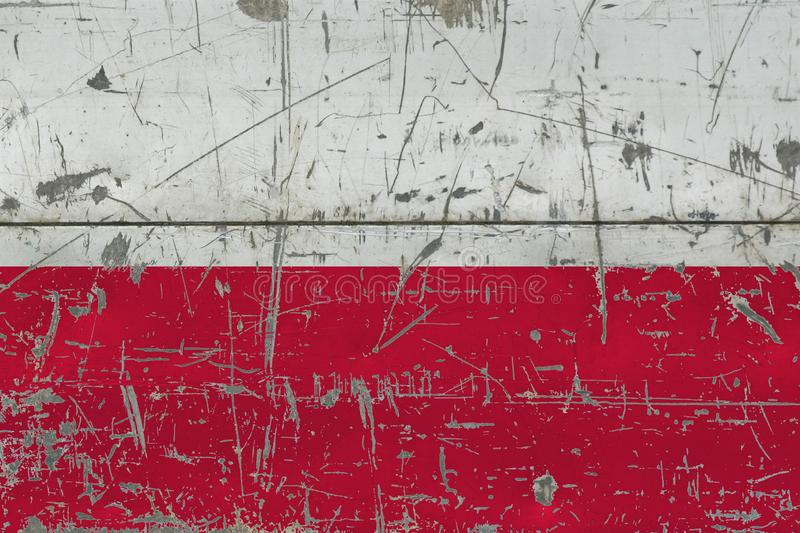 Grunge Poland flag on old scratched wooden surface. National vintage background stock photography