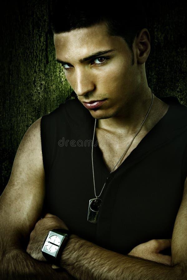 Grunge portrait of tough cool sexy man