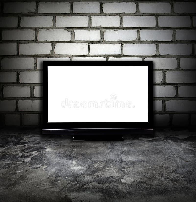 Grunge Raum und Plasma Fernsehapparat stockfotos