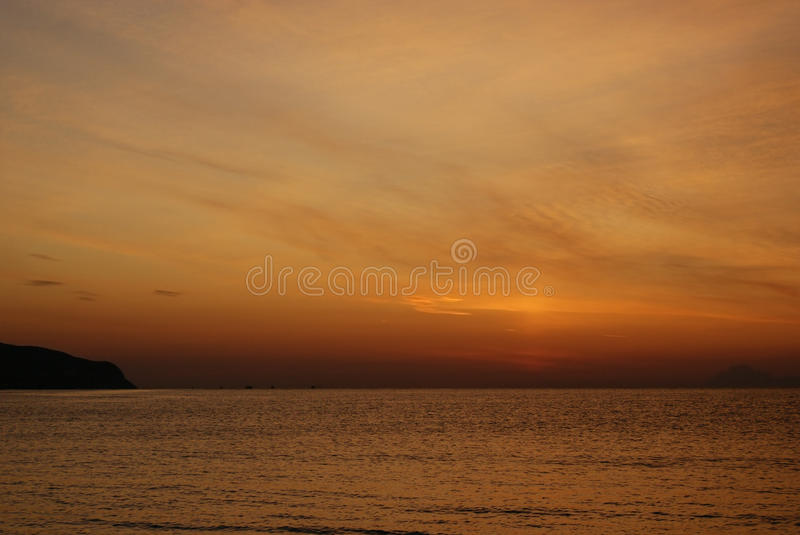 Grunge red background of sky and sea at sunrise stock image